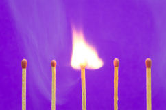 Burnning match setting on purple background for ideas and inspir Stock Photo