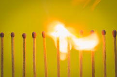 Burnning match setting on yellow background for ideas and inspir Stock Photo