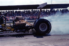Burnout. Drag racer burning rubber at the start of a race royalty free stock image