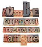 Burnout , fatigue, frustration and zombie. A collage of negative words in vintage wood letterpress printing blocks, isolated on white royalty free stock photos
