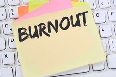 Burnout ill illness stress stressed at work business note paper. Computer keyboard Royalty Free Stock Image