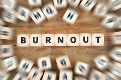 Burnout ill illness stress stressed at work overworked dice busi Stock Image
