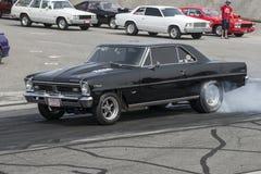Burnout nero dell'automobile Immagini Stock