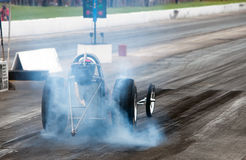 Burnout. Nitro fuel race car heating up the tires Royalty Free Stock Photo