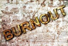 Burnout. Word with wooden letters on a peeling background royalty free stock photos