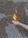 Burns with a bright flame hand. Stock Image