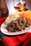 Burns Night Haggis. Scottish Haggis Serving For A Burns Night Dinner Celebrating The Birthday Of Robert Burns And A Tot Of Whiskey royalty free stock photo