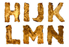 Burnt alphabet isolated on white background Royalty Free Stock Photography