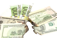Burnt bills of euro and dollar closeup Royalty Free Stock Photo