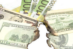 Burnt bills of euro and dollar Stock Image