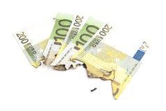 Burnt bills of euro on white Stock Photos