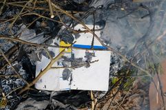 Burnt Book Above. Above shot of a burnt book, outdoor closeup royalty free stock photography