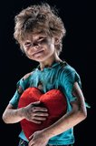 Burnt boy. Boy burnt of love with heart over white background Royalty Free Stock Photo