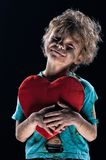 Burnt boy. Boy burnt of love with heart over white background Royalty Free Stock Image