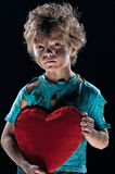 Burnt boy. Boy burnt of love with heart over white background Stock Images