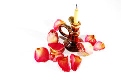 Burnt candle and dry rose with petals Stock Photo