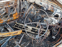 Burnt car. Burnt out interior of a car Stock Image