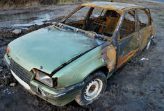 Burnt car. On the dirty background Stock Image