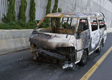 Burnt car. Burnt-out car on road shoulders Stock Images