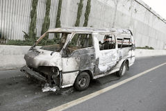 Burnt car. Burnt-out car on road shoulders Stock Photo