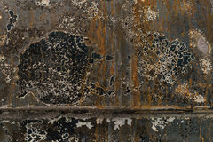 Burnt corrugated lacquer orange blue colors on rusty metal surfa Stock Images