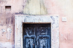 Burnt doors and colored walls Stock Image