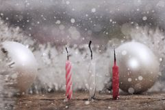 Burnt down candles, snow/ artwork in retro style Stock Images