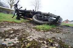 Burnt down motorbike. On the green grass Stock Images