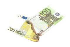 Burnt euros banknotes on white Royalty Free Stock Photography