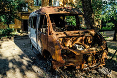 Burnt after fire rusty minibus Stock Image