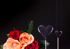 Burnt hearts with roses bouquet Royalty Free Stock Photography