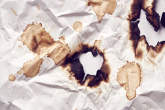 Burnt hole of paper Stock Photo