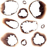 Burnt Holes in White Paper Royalty Free Stock Photography