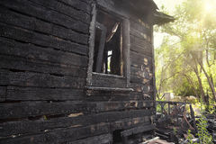 Burnt home destroyed by a house fire Stock Photos