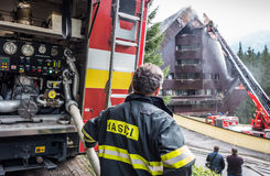 Burnt hotel Junior, Slovakia. JASNA, SLOVAKIA - OCTOBER 6: Fireman in front of hotel Junior Jasna  in Low Tatras mountains on October 6, 2015 in Jasna Royalty Free Stock Image
