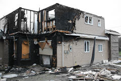 Burnt house. New house destroyed by fire. Also available in vertical Royalty Free Stock Photo