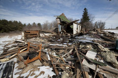 Burnt House with Debris Around It Stock Photo