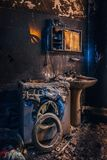 Burnt house interior. Burned burnt bathroom, Fused remains of furniture and washing machine.  royalty free stock images