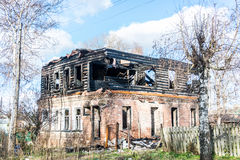 The burnt house. Two-storey house after a fire. Strongly marked black and charred logs Royalty Free Stock Photos