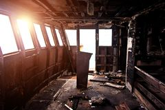 Burnt interior of ship cabin. Burnt interior of ship cabin after fire stock image