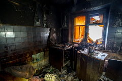 Burnt interiors of house after fire. Burned wooden furniture Stock Photo