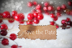 Burnt Label, Snow, Snowflakes, English Text Save The Date. Burnt Label With English Text Save The Date. Red Christmas Decoration On Snow. Cement Wall As Royalty Free Stock Images