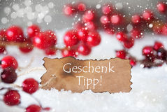 Burnt Label, Snow, Snowflakes, Geschenk Tipp Means Gift Tip Stock Photo