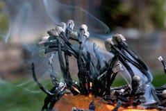 Burnt Match sticks and smoke Stock Photo