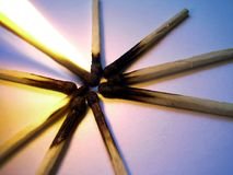 Burnt matches. A star pattern of burnt matches royalty free stock photography
