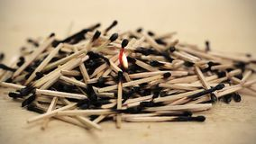 Burnt matches stack with burning match stock video footage