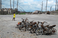 Burnt motorbike wrecks after volcano eruption. Burnt motorbike after volcanic eruption in Indonesia, leaving debris and ash from caldera, natural disaster Royalty Free Stock Photo