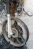 Burnt Motorcycle. Selective focus of burnt part of motorcycle in riot accident Stock Images