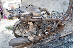 Burnt Motorcycle. Selective focus of burnt part of motorcycle in riot accident Stock Photo