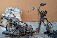Burnt Motorcycle. Selective focus of burnt motorcycle in riot accident Royalty Free Stock Photos